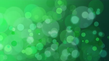 グリマー : Abstract green bokeh and particles falling. Luxury, shiny and elegant dynamic style template for holiday background