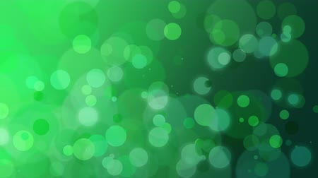 piscar : Abstract green bokeh and particles falling. Luxury, shiny and elegant dynamic style template for holiday background