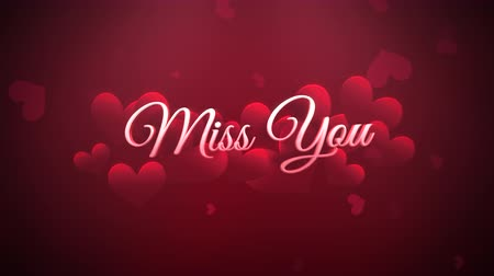 kaligrafia : Animated closeup Miss You text and motion romantic heart on Valentine day shiny background. Luxury and elegant dynamic style template for holiday