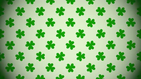 Motion green shamrocks, Saint Patrick Day animation background. Luxury and elegant dynamic style template for holiday Stock mozgókép