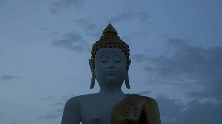 budismo : Big white Buddha time lapse from night to day.