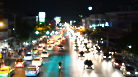 Blurred night traffic lights Bangkok Thailand.
