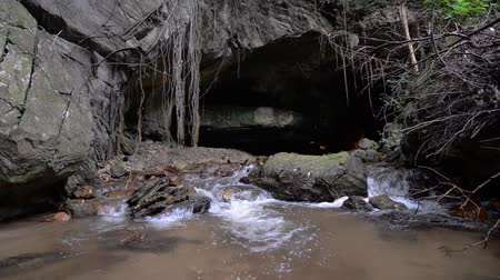 Waterfall inside of limestone cave.