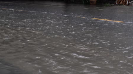Flooded road in Bangkok after raining.