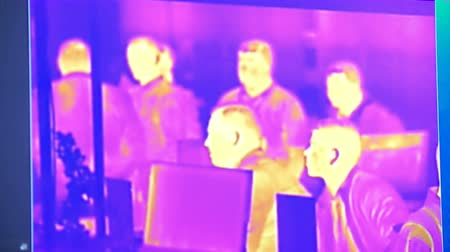 бдительность : Thermal infrared heat mapping image. Security camera. Modern technology details.