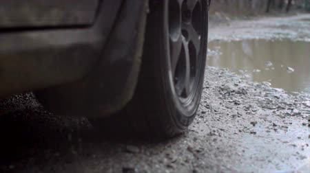 Driving a car on a country road. Slow motion. Dirt, dust, splashes