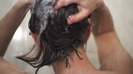 Woman Washing Her Hair. Apply shampoo to hair. Slow motion. Stock Footage