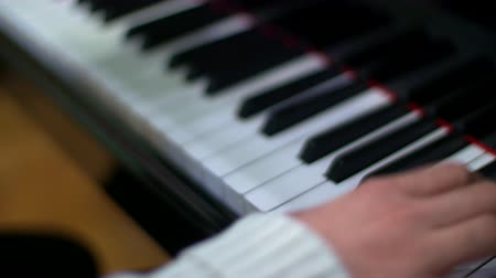 Man plays dynamic music on the piano. Close Up.