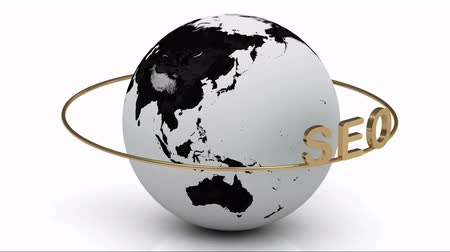 поисковая оптимизация : SEO golden on a gold ring rotates around the earth on a white background