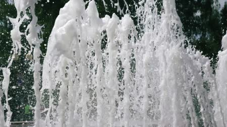 plumber : beautiful splashes of fountain water in the Park near the trees