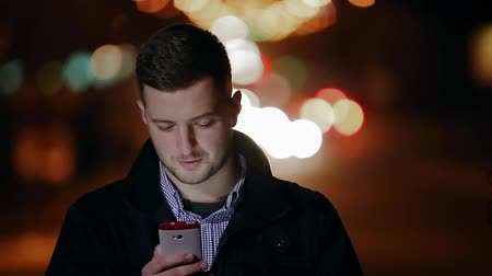 says the guy on the phone at night  night phone Stock Footage