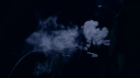 boy smoking a hookah in the club Stock Footage