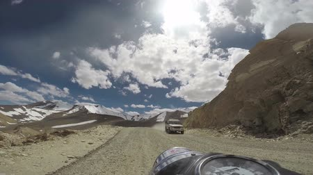 motocykl : Motorcycle riding in high mountains and oncoming car