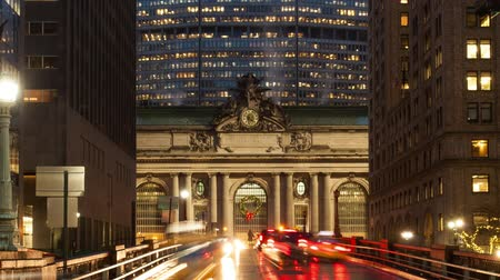 Time lapse zoom in dolly shot of traffic going in front of Grand Central Terminal station in Manhattan, New York, USA
