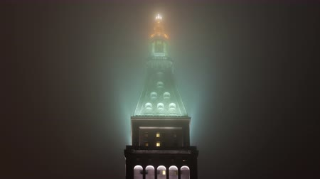 Time lapse close up shot of Metropolitan Life Insurance tower in mist at night, Manhattan, New York, USA