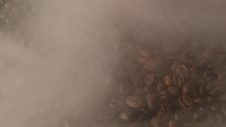 kahve çekirdeği : Roasted coffee with a smoke. Stok Video