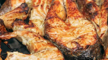 babér : Fried grilled salmon on bbq. Marinade from white sauce and lemon. Trout fish.
