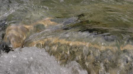 sıçramasına : Beautiful water in a mountain river in slow motion video. Shooting speed 60fps, slow motion. Live shooting of the most beautiful nature river mountain water. The camera is not static. Water part 2.