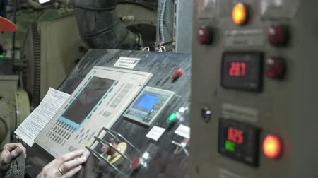 granulado : Manufacture of plastic water pipes. The man near the console is an electronic control center for production process. Manufacturing of tubes to the factory. The process of making plastic pipes on machine tool with the use of water and air pressure. Stock Footage