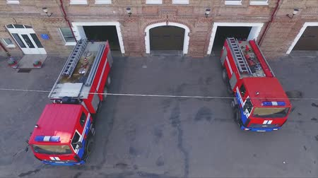 firemen : fire trucks leave the fire station