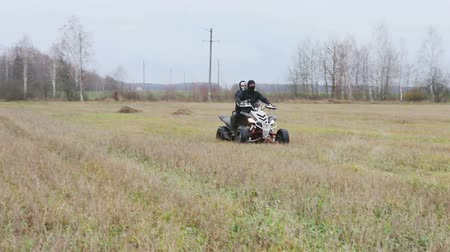 quad bike : the guy with the mask on her face riding her ATV Stock Footage