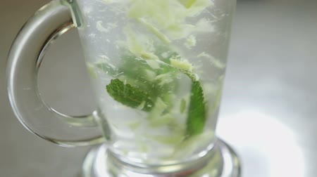 homeopati : Mixing lemon, mint, ginger, water and sugar Close up Stok Video