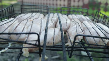 sosis : Grill with homemade sausage is laid on the grill with coals. Close up