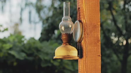 lampa naftowa : Close-up of kerosene lamp that hangs on the support of the terrace