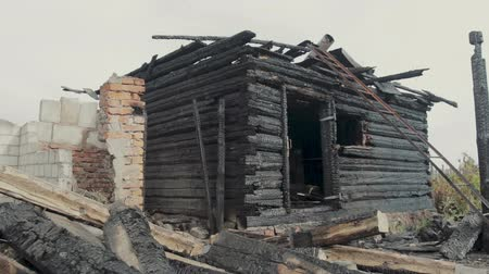 arson : The ruins of an old wooden house destroyed by fire. Steadicam shot