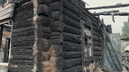 charred : The ruins of an old wooden house destroyed by fire. Steadicam shot