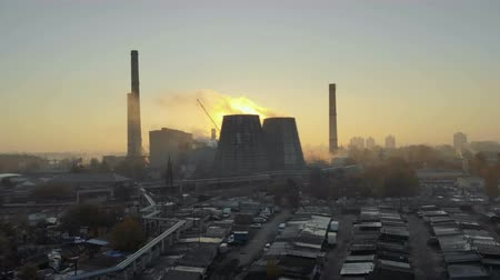 hazardous : Aerial view of the smoking pipes of the plant at sunset. Environmental pollution. Panorama of the city with pipes and smoke. The concept of ecology, climate
