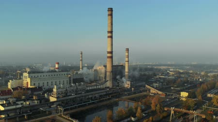 emissions : Enterprise with Smoking pipes in the city, environmental disaster, chemical industry. Aerial view. The concept of pollution Stock Footage