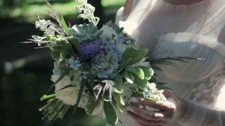 atributo : Stedicam shot close-up with a beautiful wedding bouquet in the hands of the bride Stock Footage