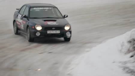 ралли : BOBRUISK, BELARUS-FEBRUARY 2, 2019: Sports car drifting on snow-covered terrain. Rally cross on ice