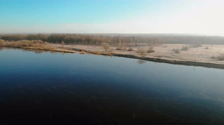 dolu : Panorama of a full-flowing navigable river in the soft spring sun. Aerial shot