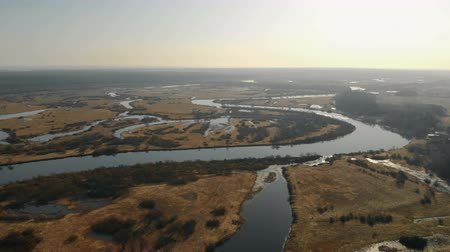 locatie : Aerial view of the picturesque deep river with water banks, Islands and tributaries in bright sunlight