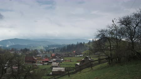 viver : Beautiful panorama of the Carpathian village on the background of picturesque mountains, where Hutsuls live. Wild forest, valley, fields and pastures, Ukraine