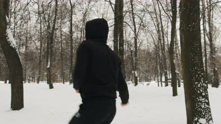 combate : One young guy in a black suit during karate training, kata exercise in winter outdoors Vídeos