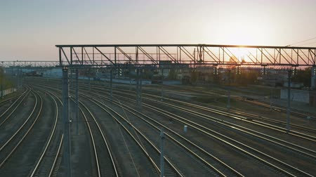 revolução : Timelapse shot of a set of empty train tracks against the setting sun. The concept of Simferopol railway station after the annexation of Crimea by the state of the Russian Federation