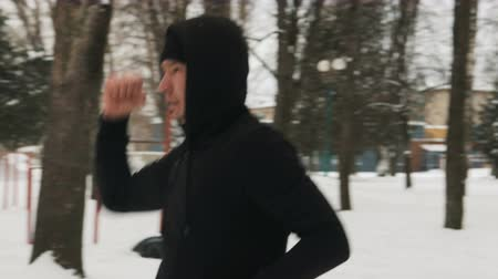 무술 : One young guy in a black suit during karate training, kata exercise in winter outdoors 무비클립