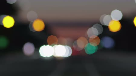 dairesel : Car headlights turn into bokeh lights. Bokeh defocused lights Stok Video