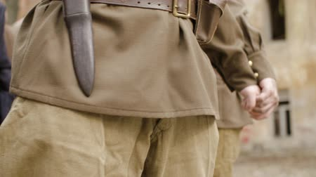 Steadicam shot close-up of soldiers in world war II uniform brown holding hands. The concept of brave warriors Стоковые видеозаписи