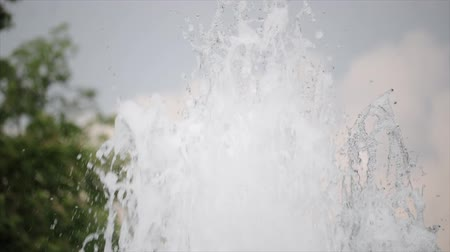 Close-up of a spray of clean, clear water soaring up. The concept of a refreshing spring, a fountain in the city during the heat