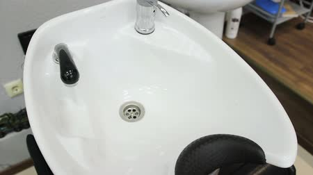 Sink for hair salon beauty. Interior in the barber shop Стоковые видеозаписи