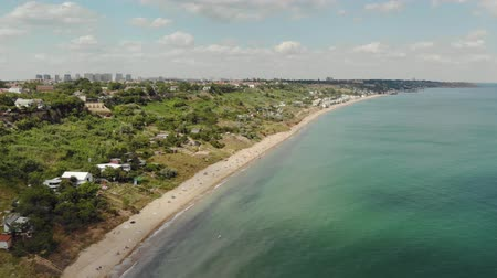 odstín : Aerial view of the sandy coast with water green-blue shade near the city of Odessa in Ukraine. Coastline with vacationing tourists