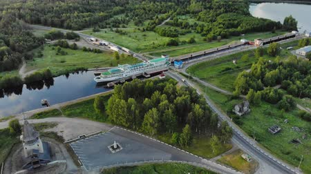 tersane : Russia, Povenets-26 JUNE 2019. Aerial view of a white cruise ship passing the narrow gateway of the white sea-Baltic canal in Karelia. The concept of navigation on the Northern sea route Stok Video