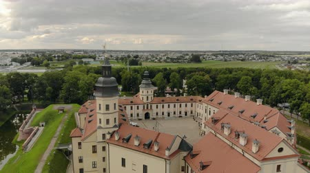 templomtorony : Nesvizh, Belarus-AUGUST 16, 2019. Panorama of the famous, old, medieval castle of the 16th century. The Palace and Park complex and the former residence of the Radziwill noble family. Aerial view