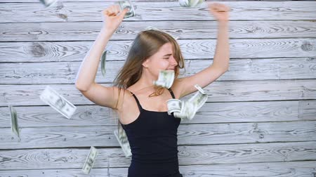 orgazm : young woman is happy with falling money Wideo