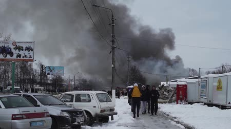 vehicle extrication : Chernivtsi  Ukraine - 03192018: Market with carpets is on fire. People try to help