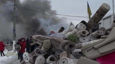 čelisti : Chernivtsi  Ukraine - 03192018: Market with carpets is on fire. People try to help